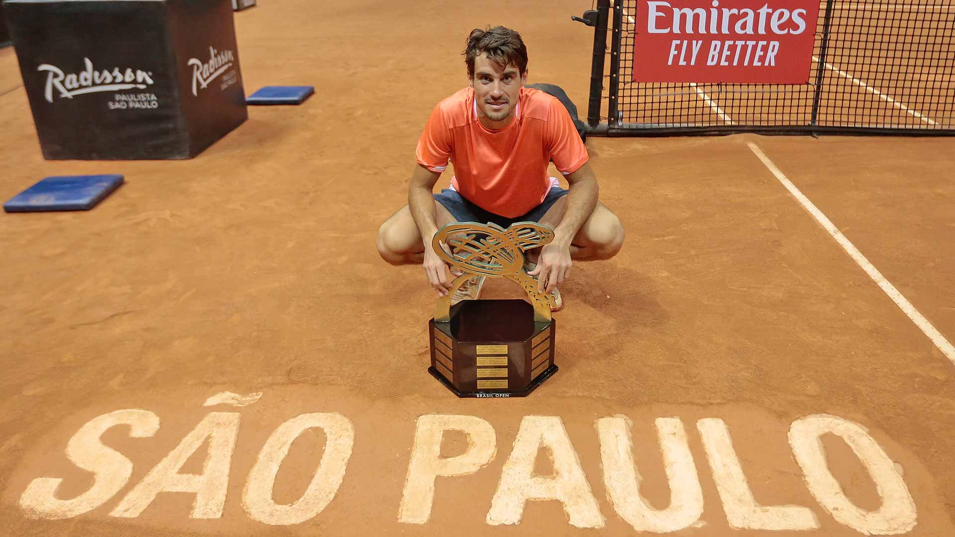 Guido Pella poses with his first ATP Tour trophy in Sao Paulo