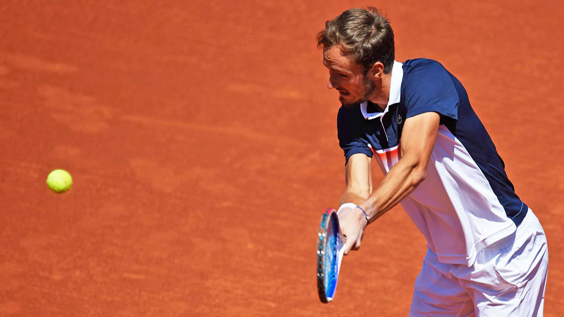 Daniil Medvedev hits a backhand in Barcelona